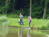 Leconfield Fly Fishing Club Landing a trout at Jackson's Lake